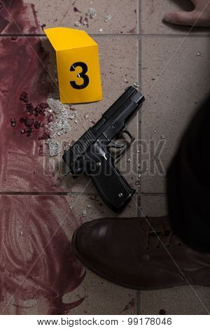 Close-up of blood and gun - evidence of murder poster