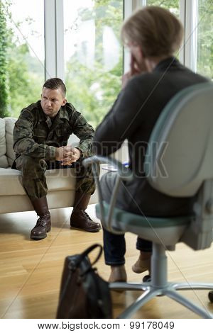 Soldier with physical trauma at psychiatrist's office poster