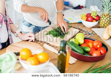 Gorgeous young Women preparing dinner in a kitchen concept cooking, culinary, healthy lifestyle poster