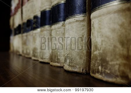 Long row of old leather law books on a shelf