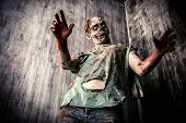 Scary bloody zombie man in the old house. Horror. Halloween.  poster