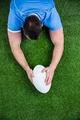 Rugby player scoring a try on astro turf grass poster