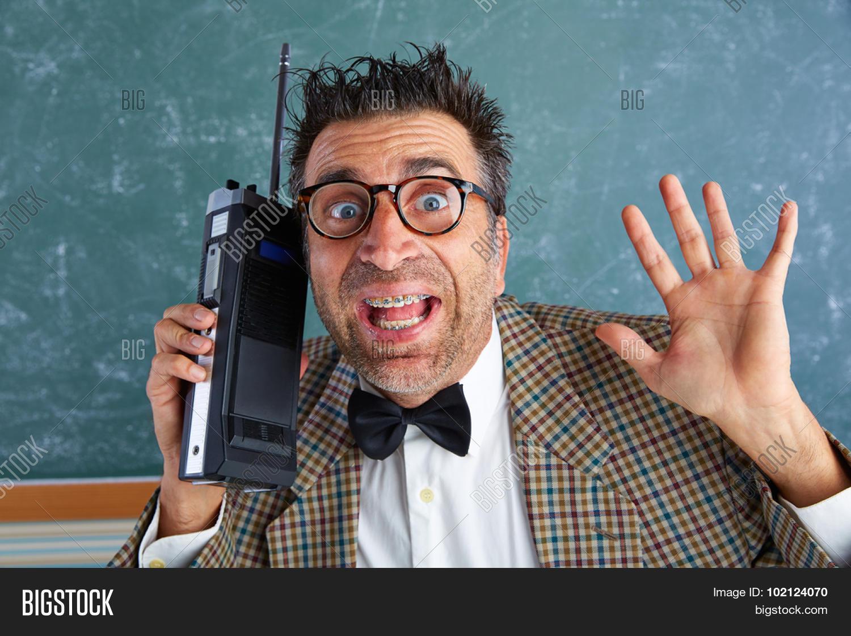d7b327a5f2f2 Nerd silly private investigator with retro walkie talkie on teacher  bLAckboard