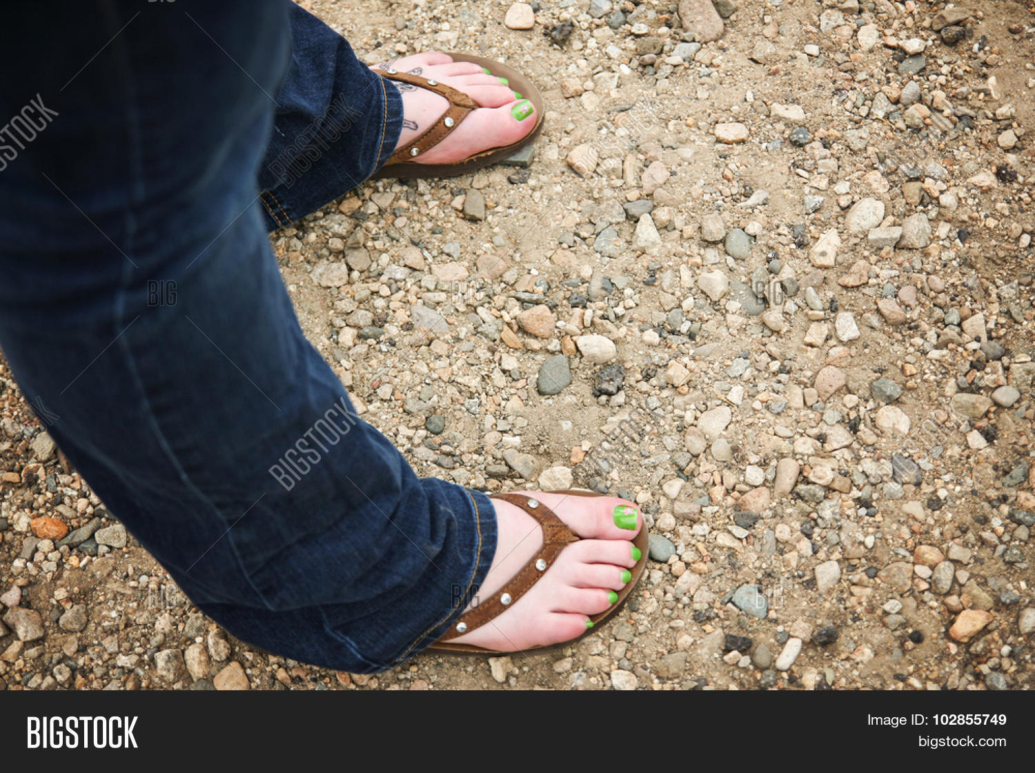 4585d635fb6ebf a girl wearing brown leather flip flop sandals on her feet with little  rhinestone jewels on