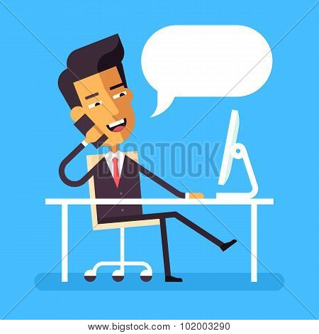 Handsome asian manager in formal suit sitting legs crossed at the desk with a computer and talking o