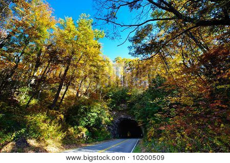 Mountain tunnel and beautiful fall colors on the Blue Ridge Parkway poster