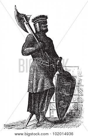 Armor and weapons during the first Crusades era, old engraving. Vector, engraved illustration of Crusade knight, in mail armor, with hauberk, shield and sword.