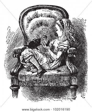 Alice talks to the Kitten - Through the Looking Glass original book vintage engraving. Do you know, I was so angry, Kitty,? Alice went on as soon as they were comfortably settled again...