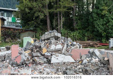 heap of broken bricks and concrete on demolition site
