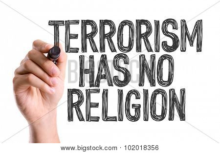 Hand with marker writing: Terrorism Has No Religion