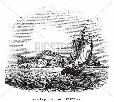 Staffa in Argyll and Bute, Scotland, during the 1890s, vintage engraving. Old engraved illustration of Staffa with running ships in front and island in back.  Trousset encyclopedia (1886 - 1891).