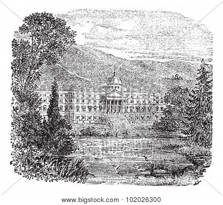 Schloss Wilhelmshohe in Kassel, Germany, during the 1890s, vintage engraving. Old engraved illustration of Schloss Wilhelmshohe with pond in front. Trousset encyclopedia (1886 - 1891).