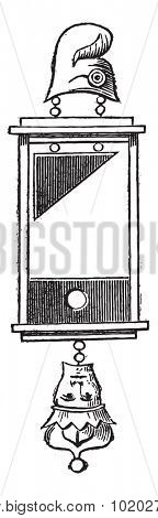 Old engraved illustration of earring of guillotine (1793) isolated on a white background. Industrial encyclopedia E.-O. Lami - 1875.