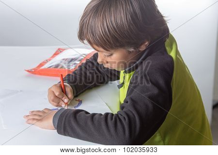 Boy Doing School Work - Homeschool.