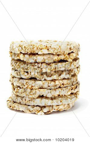 a pile of rice cakes isolated on a white background poster