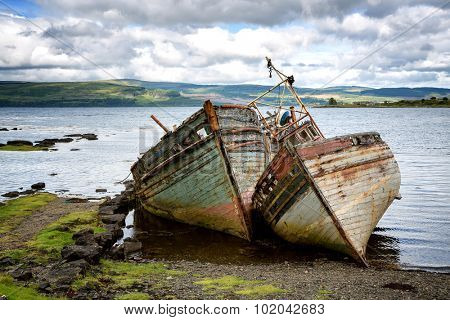 Two abandoned fishing boats in Salen Sound, Isle of Mull, Inner Hebrides, Scotland.