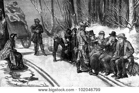 On the highway of Santa fe. One of desperados emptied the pockets carefully, vintage engraved illustration. Journal des Voyage, Travel Journal, (1880-81).