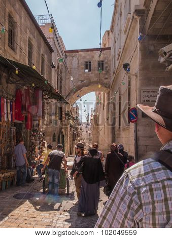 Jerusalem, Israel - July 15, 2015: Narrow Stone Street Among Stalls With Traditional Souvenirs And G