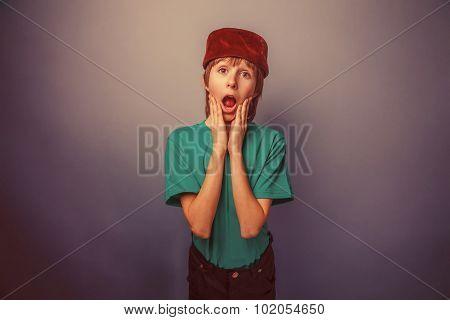 Muslim boy of ten years, skullcap, surprise, his hands on his fa