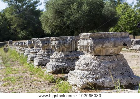 Remains Of A Corinthian Column In Olympia, Greece