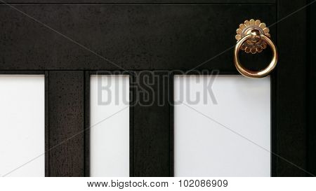 old temple black door and doorknob