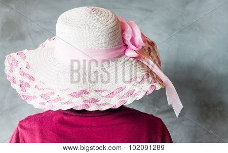 Woman With Pink Hat On Grey Background