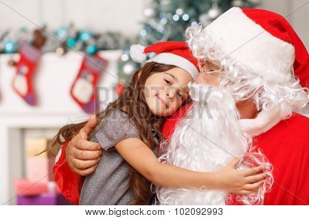 Pretty girl sitting with Santa