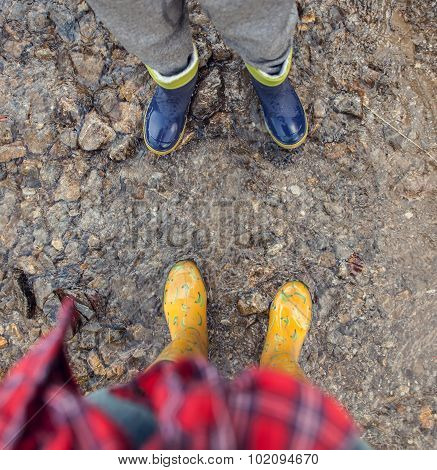 Two Pairs Legs In Colorful Gumboots