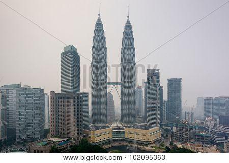 KUALA LUMPUR - SEPTEMBER 17, 2015: Smoke from forest fires in Sumatra blows across the Malay Peninsula causing haze in Kuala Lumpur City Center.