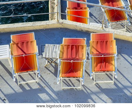 Orange Sunbeds At A Terrace At The Corniche In Marseille