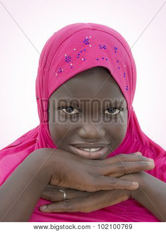 Smiling girl wearing a pink headscarf, ten years old
