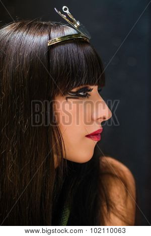 Profile portrait of girl in style of Egyptian Pharaoh Cleopatra