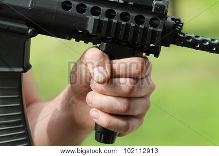 soldier shoot at a target with automatic weapon