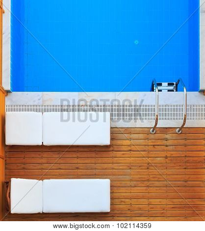 Top View Of Sunbeds Near Private Pool