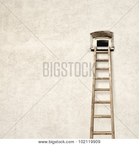 wall with a small window and wooden ladder