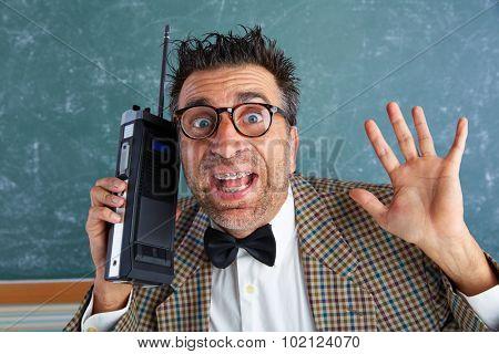 Nerd silly private investigator with retro walkie talkie on teacher bLAckboard