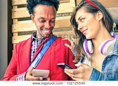 Multiracial Couple Flirting With Smartphone Numbers - Modern Concept Of Mobile Phone Technology