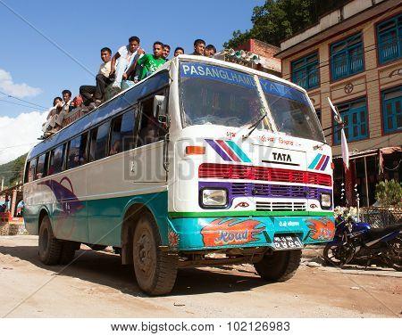 People Traveling On Top Of Autobus Brand Tata
