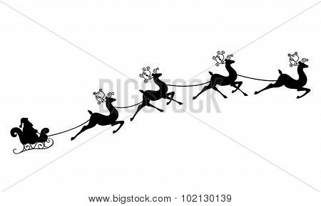 Santa Claus rides in a sleigh  on the reindeer