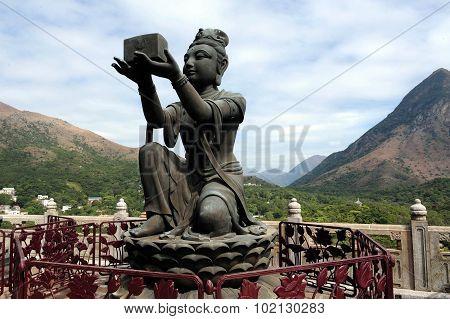Bodhisattvas offering gift to Buddha - from Tian Tan Buddha Lantau Island Hong Kong China Photo by Rafael Ben-Ari/Chameleons Eye