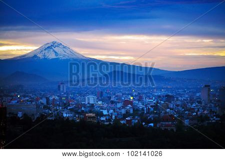 A night view of Popocatépetl Volcano Mountain Behind Mexico City.
