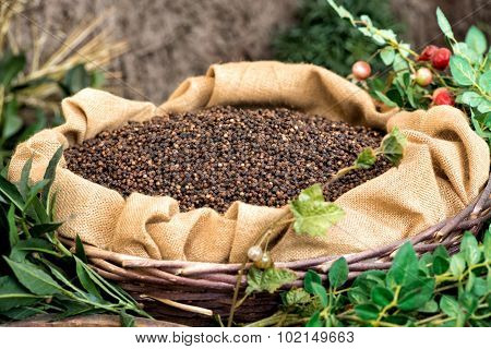 Rustic Display Of Dried Black Peppercorns