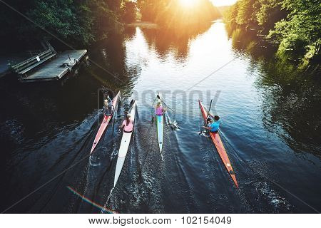 Team Of Rowing People