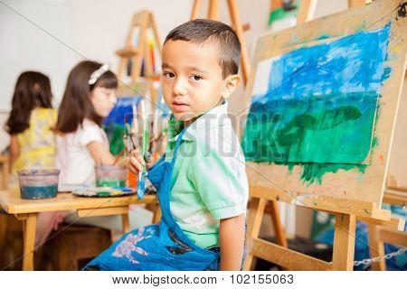 Latin Boy Painting In Art Class