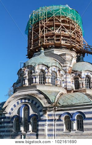 Russian orthodox church tower under restoration in scaffolding. poster