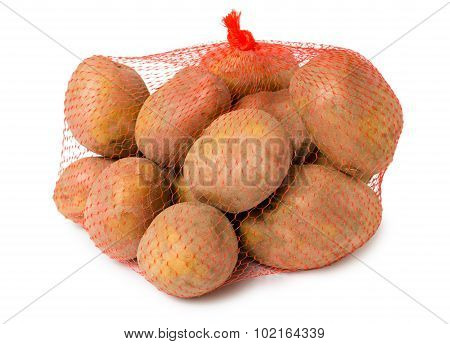 Crude unpeeled potatoes in the mesh bag isolated on white background poster