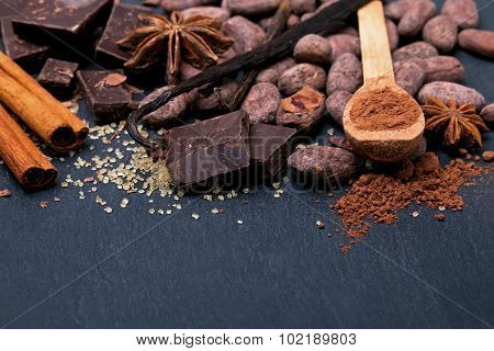 Cocoa, Chocolate And Spices On Black Background