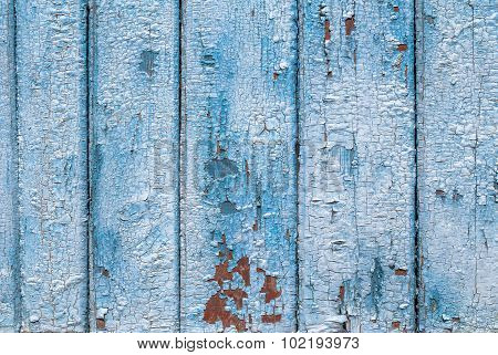 texture of wooden surface with remnants of old paint that has dried and cracked under the influence