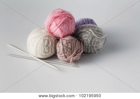 Clews Of Colored Yarn With Niddle