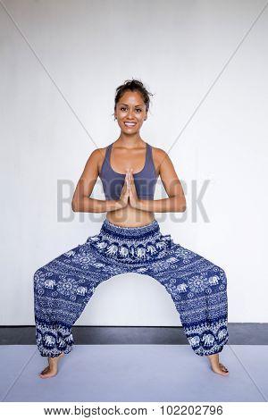 Young beautiful woman wearing harem pants.